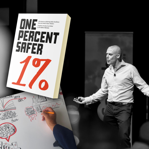 Image of the 1% book and Andrew Sharman on stage